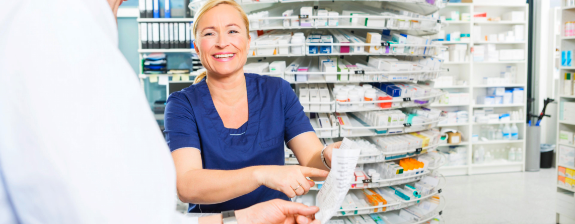 Happy pharmacist assisting a customer