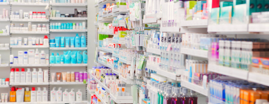 Pharmacy shelves full of medical supplies