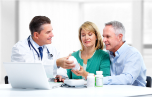 Pharmacist talking to a couple