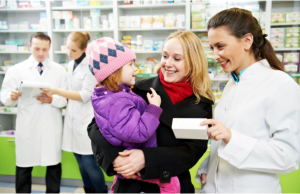 Pharmacist talking to a mother and a child